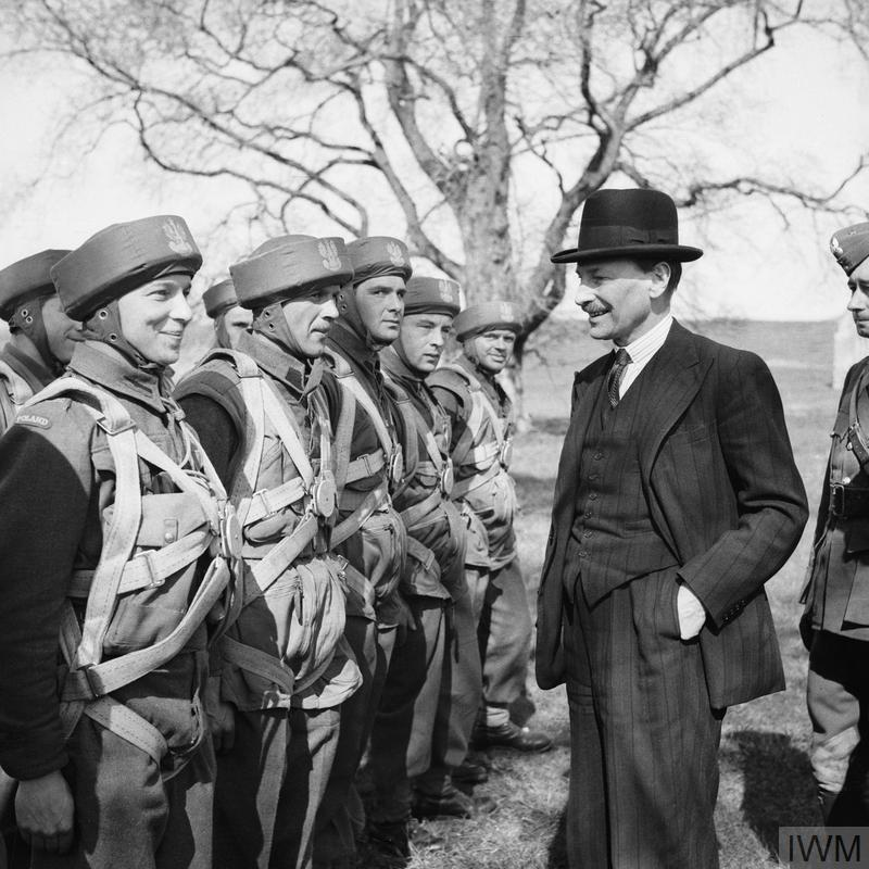 THE POLISH ARMY IN BRITAIN, 1940-1947 (H 18882) Clement Attlee visiting troops of the 1st Polish Independent Parachute Brigade at Cupar, 20 April 1942. Note their headwear - paratrooper's training helmets also known as 'bungee helmets'. Copyright: © IWM. Original Source: http://www.iwm.org.uk/collections/item/object/205194899