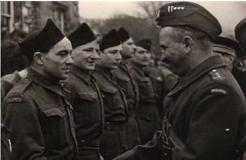 General Anders inspecting troops outside Largo House. Note the French soldier.